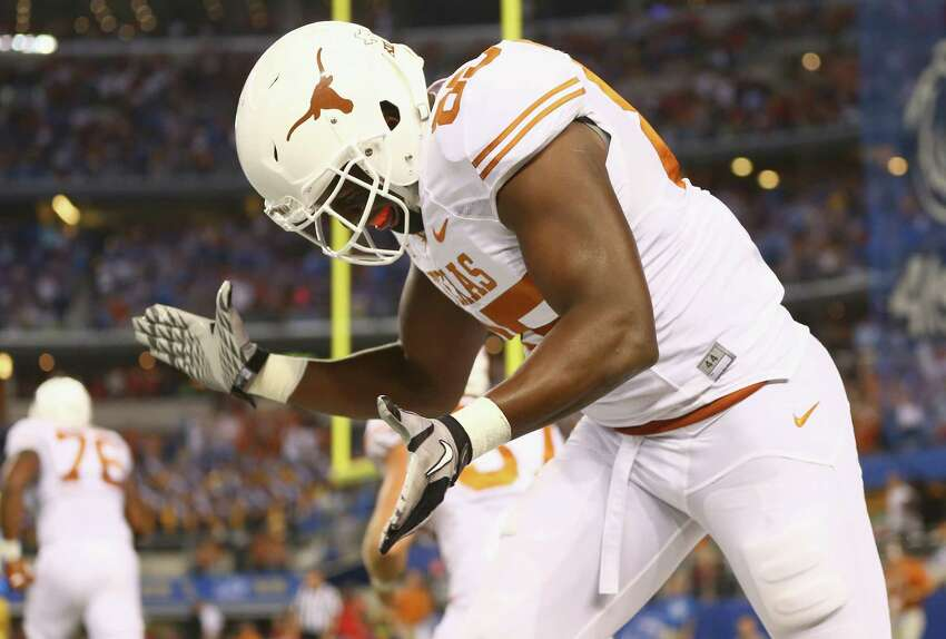 ARLINGTON, TX - SEPTEMBER 13: M.J. McFarland #85 of the Texas Longhorns celebrates a touchdown against the UCLA Bruins in the second quarter at AT&T Stadium on September 13, 2014 in Arlington, Texas.