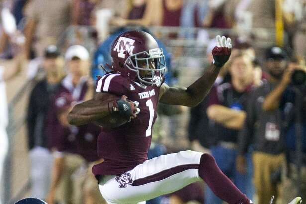 Texas A&M Aggies running back Brandon Williams shakes a tackle from Rice Owls safety Garrett Fuhrman, left, during the first half of an NCAA football game at Kyle Field Saturday, Sept. 13, 2014, in College Station. (Cody Duty / Houston Chronicle)