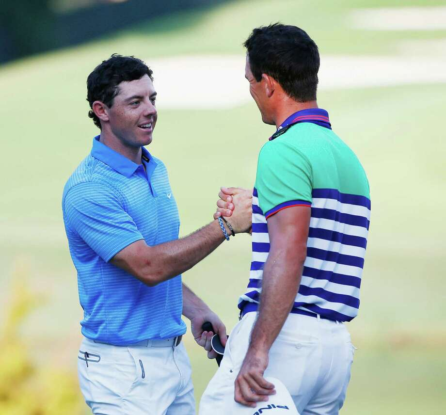Rory McIlroy (left) and Billy Horschel face off with a chance to win the $10 million FedEx Cup. They can do that by winning the Tour Championship, where they're tied for the lead. Photo: Sam Greenwood / Getty Images / 2014 Getty Images