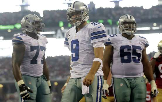 Cowboys QB Tony Romo (center), flanked by linemen Tyron Smith (left) and Ronald Leary, is expecting to have a sharper performance against the Titans than he had against the 49ers. Photo: LM Otero / Associated Press / AP
