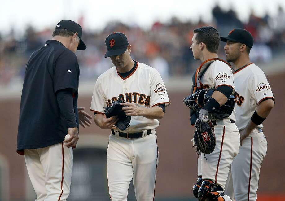 San Francisco Giants starting pitcher Tim Hudson, center, is taken out of the baseball game by manager Bruce Bochy, left, during the second inning against the Los Angeles Dodgers on Saturday, Sept. 13, 2014, in San Francisco. Photo: Tony Avelar, Associated Press