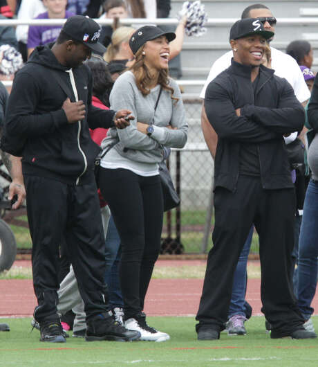 Ray Rice (right) and his wife Janay enjoy a high school football game Saturday at his alma mater in New Rochelle, N.Y., after video of him punching her led to his release by the Ravens. Photo: Carucha L. Meuse / Associated Press / The Journal News