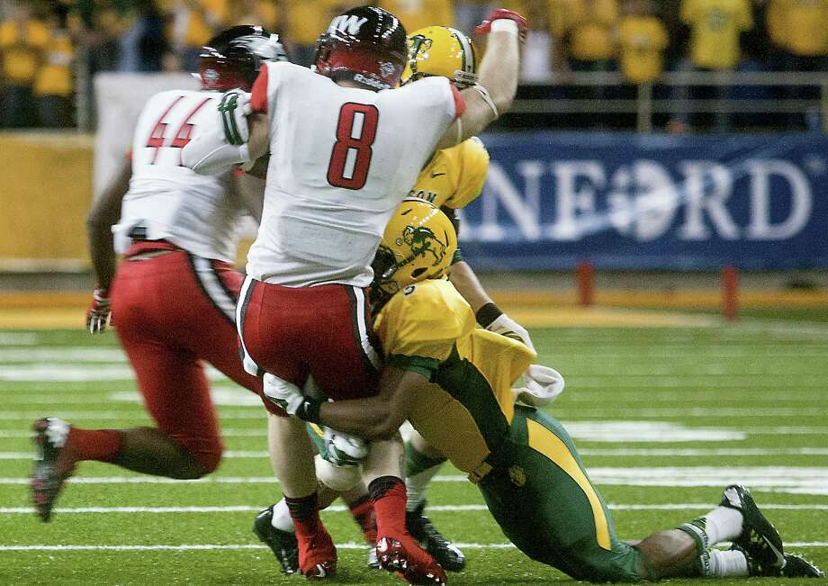 North Dakota State cornerback Jordan Champion (right) stops UIW receiver Carson Jennings in the first half of a long day for the Cardinals, who have been outscored 145-16 this season. Photo: Bruce Crummy / Associated Press / FR6524 AP