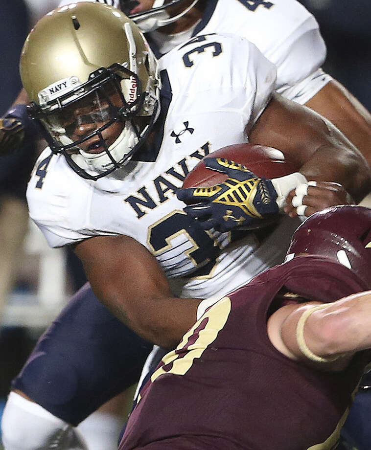 Noah Copeleand, a former Brandeis High standout, gains some of his 116 yards rushing. Photo: Tom Reel / Express-News