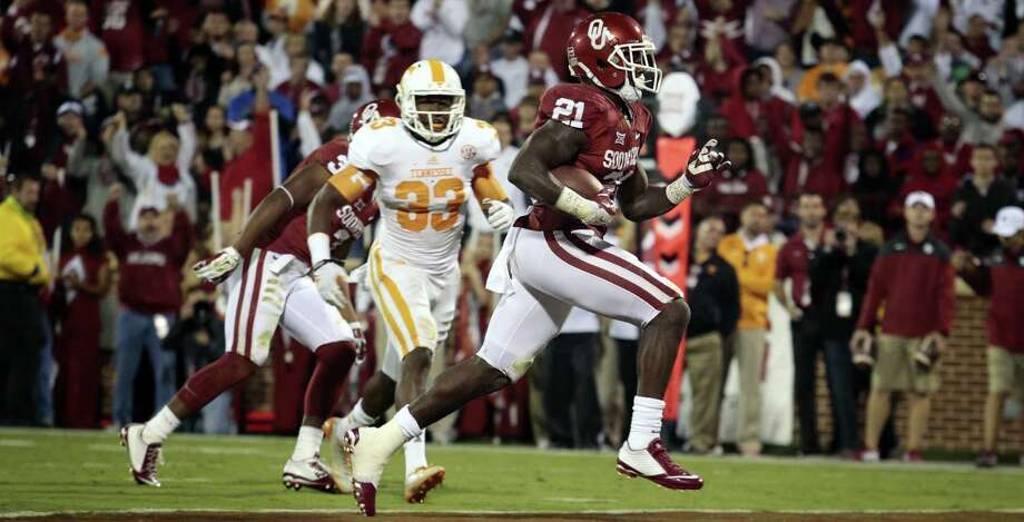 Oklahoma running back Keith Ford rushes for a touchdown against Tennessee on Saturday. Ford also caught a touchdown pass for the Sooners, who won their seventh consecutive game. Photo: Brett Deering / Getty Images / 2014 Getty Images