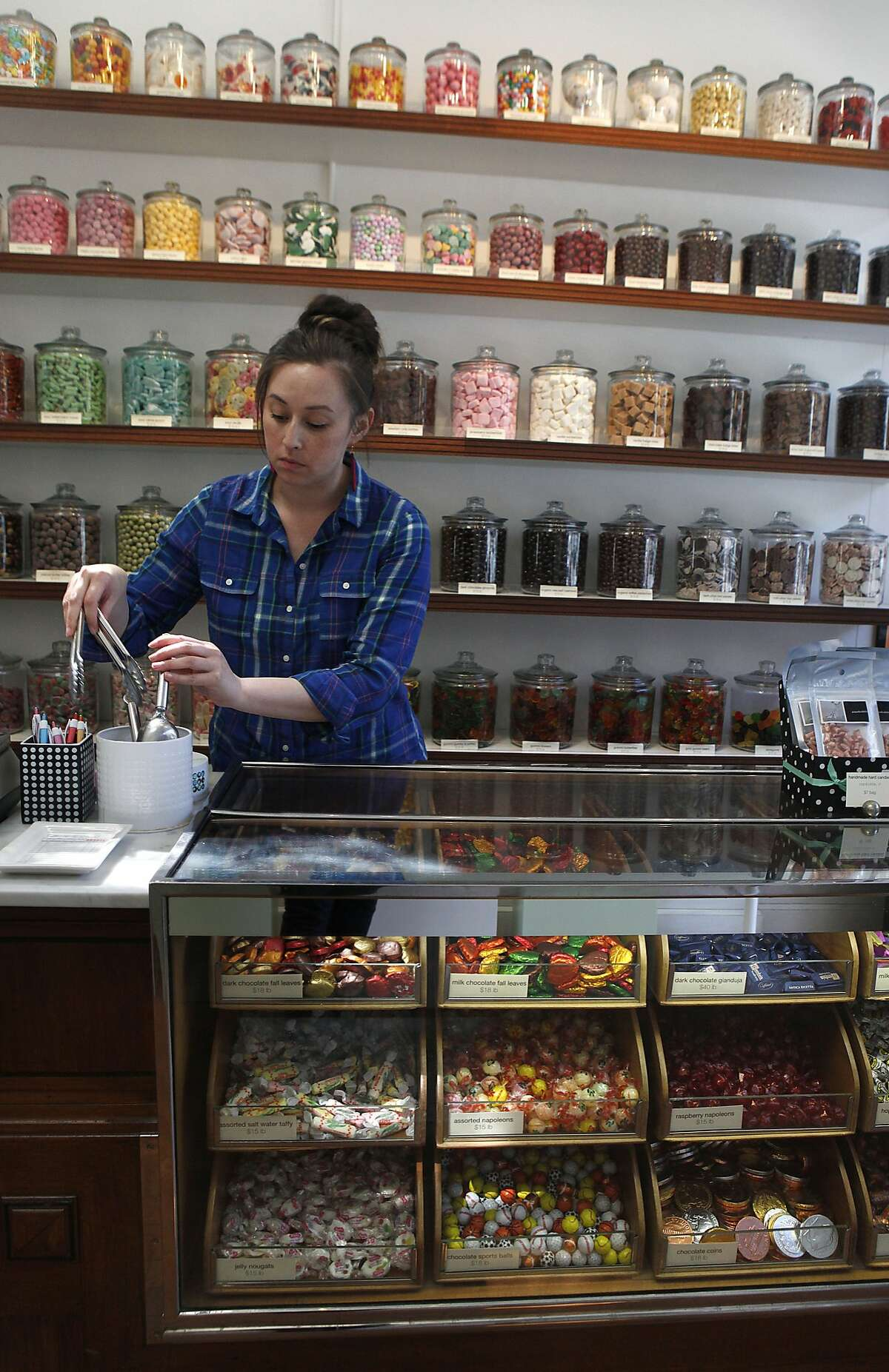 Store manager Liana Miyamura works at the Candy Store in San Francisco, Calif., on Friday, September 5, 2014.