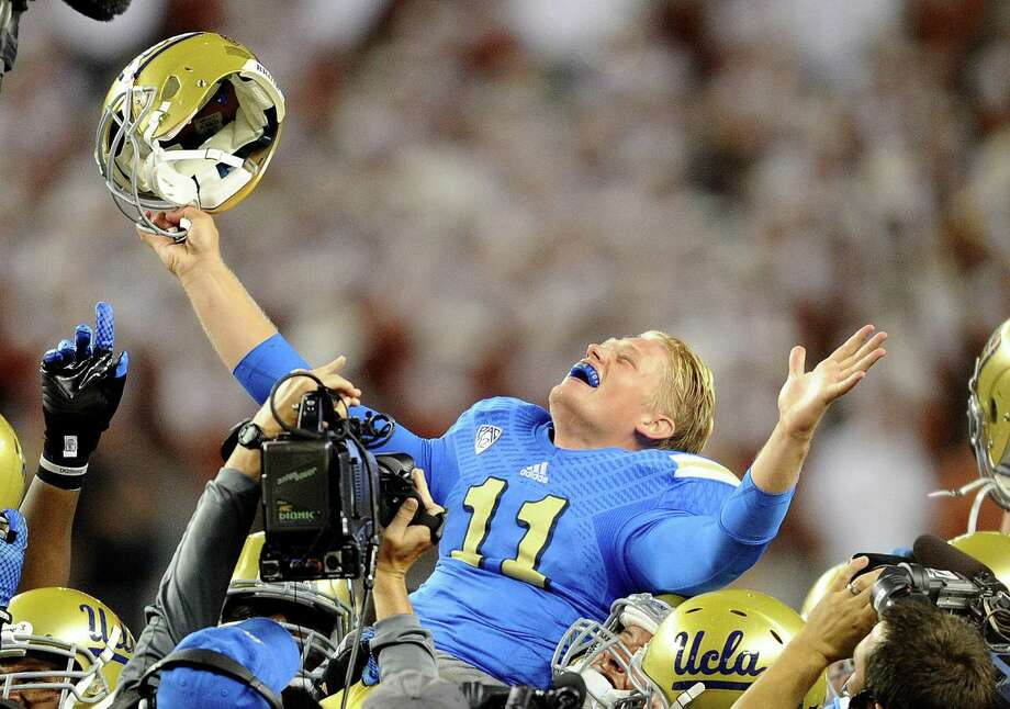 UCLA backup quarterback Jerry Neuheisel is lifted into the air by teammates after the Bruins rallied past Texas on Saturday. Starting QB Brett Hundley left in the first quarter with a left arm injury. Photo: Wally Skalij, McClatchy-Tribune News Service / Los Angeles Times