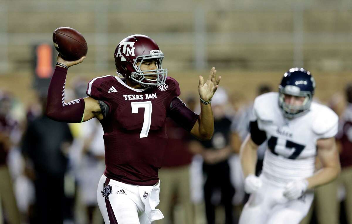 Texas A&M quarterback Kenny Hill (7) throws a pass against Rice during the first quarter of an NCAA college football game Saturday, Sept. 13, 2014, in College Station, Texas.