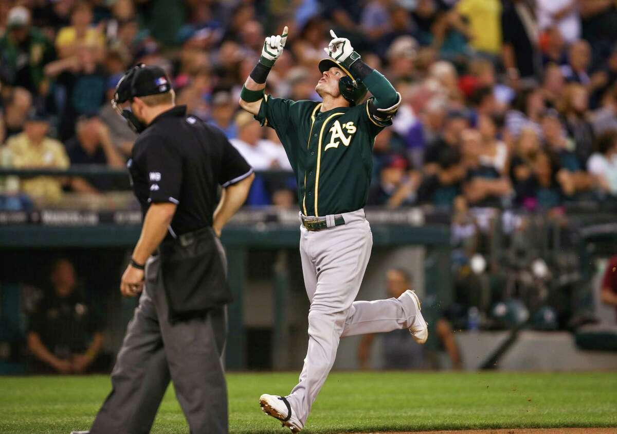Oakland Athletics player Josh Donaldson rounds the bases after hitting a solo home run against the Seattle Mariners in the 6th inning as both teams compete for a wildcard spot in the playoffs. Photographed on Saturday, September 13, 2014 at Safeco Field..
