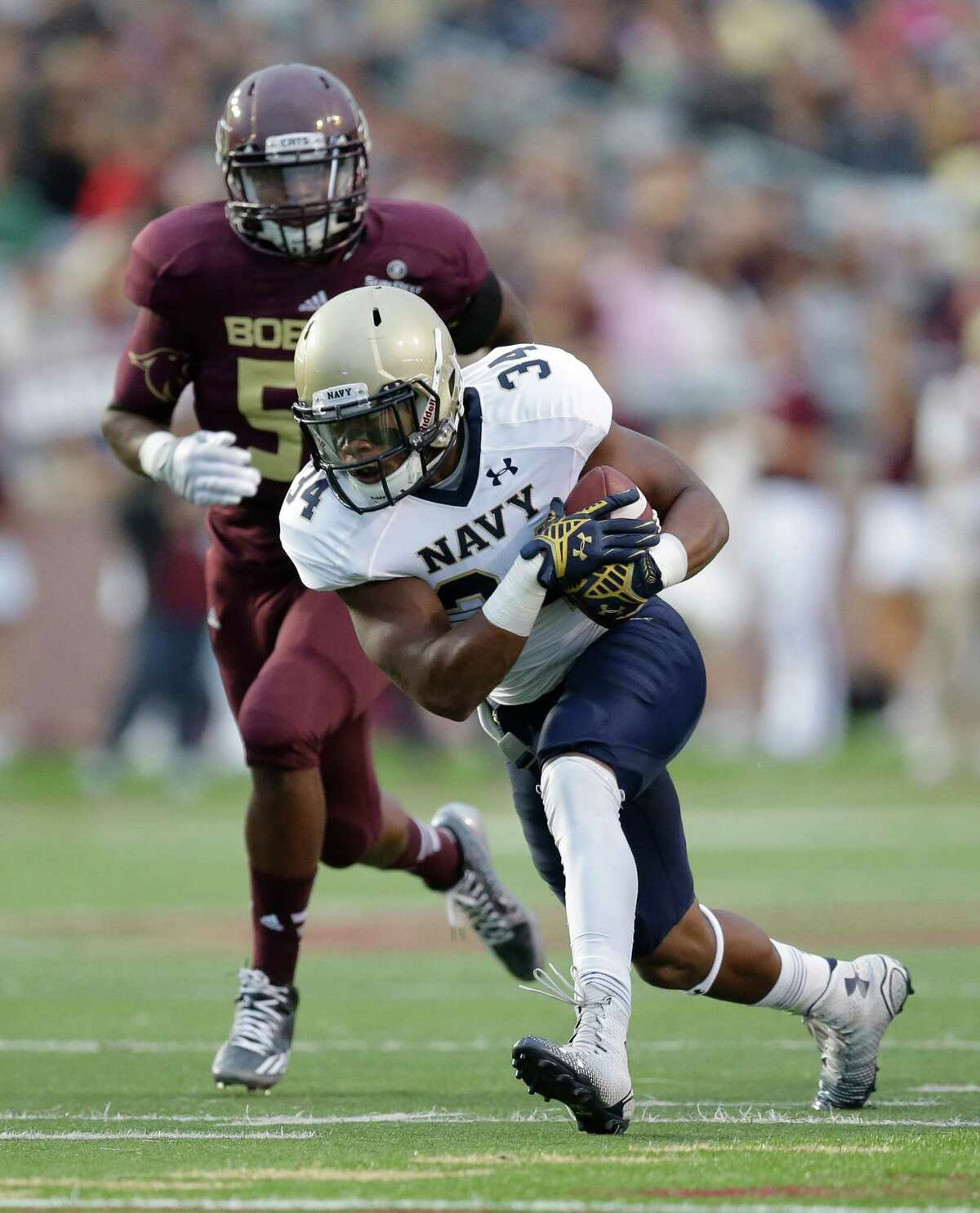 Navy 's Noah Copeland (34) breaks a tackle against Texas State during the first half of an NCAA college football game, Saturday, Sept. 13, 2014, in San Marcos, Texas.