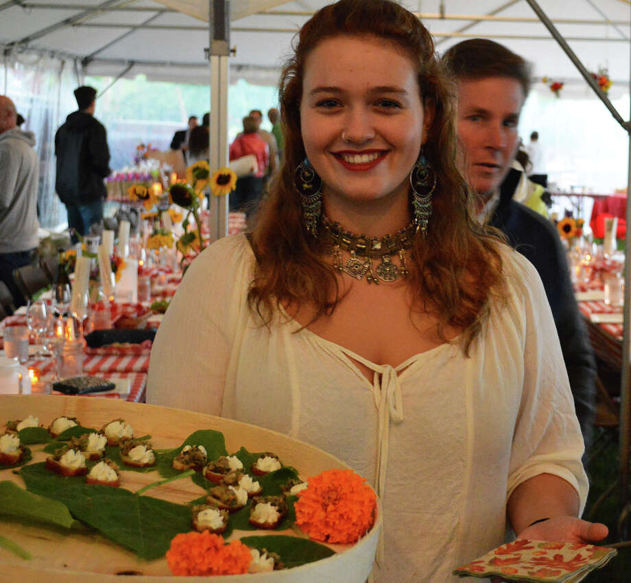 Sasha Rose McCay, who teaches at Wakeman Town Farm, helped to serve some of the savory treats Saturday at the farm's Harvest Fest. Photo: Jarret Liotta / Westport News