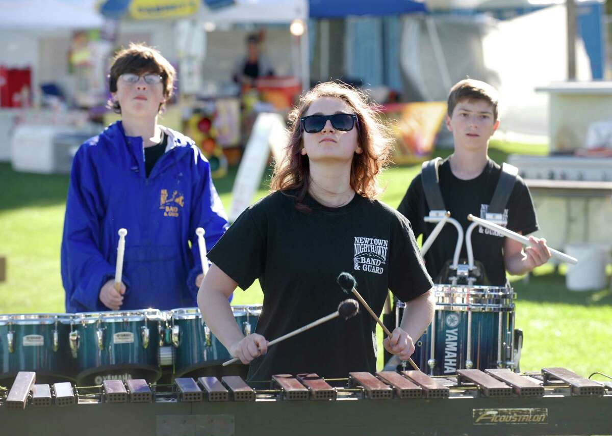 Noelle Veillette, 17, of Newtown, plays for the Newtown High School Marching Band at the opening of the Newtown Arts Festival 2014, held at the Fairfield Hill Campus, in Newtown, Conn, on Sunday, September 14, 2014. Veillette is playing the marimba.