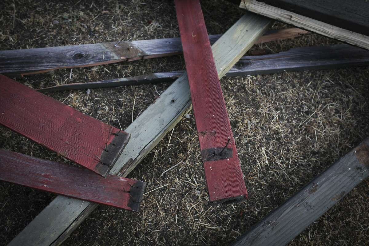Broken wood from a collapsed deck in Oakland which injured 9 people, three critically, as seen on September 14th 2014.