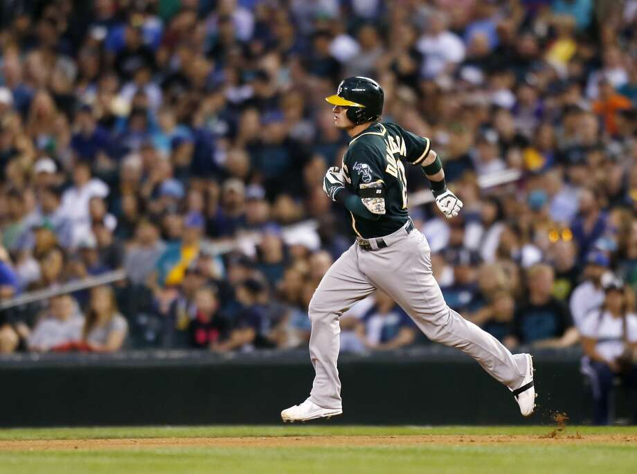 Oakland Athletics' Josh Donaldson rounds the bases after hitting a home run against the Seattle Mariners during a baseball game on Saturday, Sept. 13, 2014 in Seattle. (AP Photo/John Froschauer) Photo: John Froschauer, Associated Press