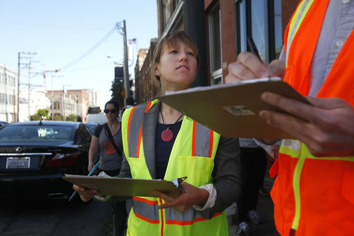 Casey Osborn, left, and Jimmy Shoemaker of SFMTA keep count of all the vehicles blocking the intersection or crosswalk at 2nd and Bryant streets as part of San Francisco Municipal Transportation Agency's (SFMTA) testing of