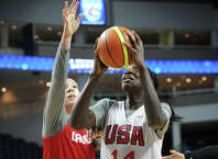 Former UCONN women's basketball and current WNBA star Tina Charles drives to the basket during a Team USA scrimmage with Team Canada at the Webster Bank Arena in Bridgeport, Conn. on Sunday, September 14, 2014. The teams play a televised game at the arena on Monday at 7 pm.