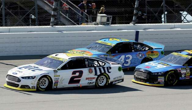 Brad Keselowski (2) drives in front of Aric Almirola (43) and Greg Biffle during the NASCAR Sprint Cup series auto race at Chicagoland Speedway in Joliet, Ill., Sunday, Sept. 14, 2014. (AP Photo/Nam Y. Huh)  ORG XMIT: ILNH114 Photo: Nam Y. Huh / AP
