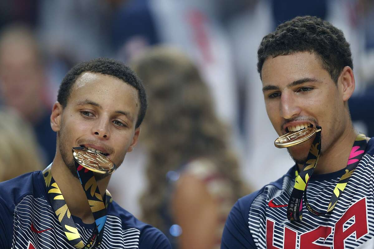 United States' Stephen Curry, left, and Klay Thompson celebrate after wining the final World Basketball match against Serbia at the Palacio de los Deportes stadium in Madrid, Spain, Sunday, Sept. 14, 2014. (AP Photo/Daniel Ochoa de Olza)