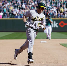 Brandon Moss runs the bases after his HR in the seventh, his first since July 24.