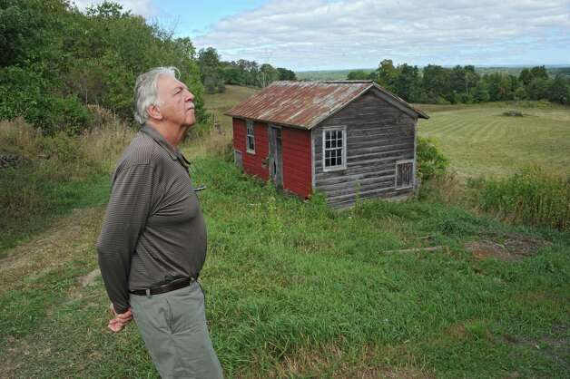Conservancy member Chris Frey looks at the big red barn that the New Baltimore Conservancy group is renovating on Friday, Sept. 12, 2014 in New Baltimore, N.Y. The group will have their grand ribbon cutting on Sept. 20 where they will be giving tours of the Scenic Hudson's Long View Park's new trails, on left of out building and they will also have music in the big red barn. (Lori Van Buren / Times Union) Photo: Lori Van Buren / 00028584A
