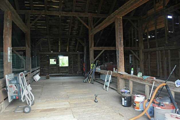 View of the upper interior of the big red barn that the New Baltimore Conservancy group is renovating on Friday, Sept. 12, 2014 in New Baltimore, N.Y.  The group will have their grand ribbon cutting on Sept. 20 where they will be giving tours of the Scenic Hudson's Long View Park's new trails and barn. (Lori Van Buren / Times Union) Photo: Lori Van Buren / 00028584A