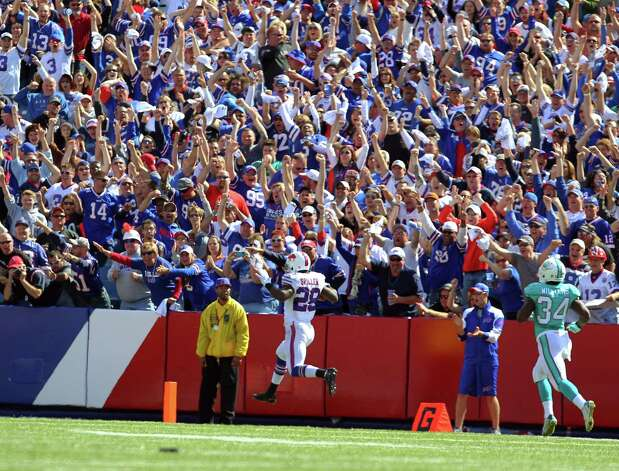 Buffalo Bills running back C.J. Spiller (28) returns a kickoff for a touchdown during the second half of an NFL football game Sunday, Sept. 14, 2014, in Orchard Park, N.Y. (AP Photo/Bill Wippert) ORG XMIT: NYMG109 Photo: Bill Wippert / FR170745 AP