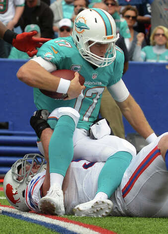 Miami Dolphins quarterback Ryan Tannehill (17) is sacked by Buffalo Bills defensive tackle Kyle Williams (95) during the first half of an NFL football game Sunday, Sept. 14, 2014, in Orchard Park, N.Y. (AP Photo/Gary Wiepert) ORG XMIT: NYMG106 Photo: Gary Wiepert / FR170498