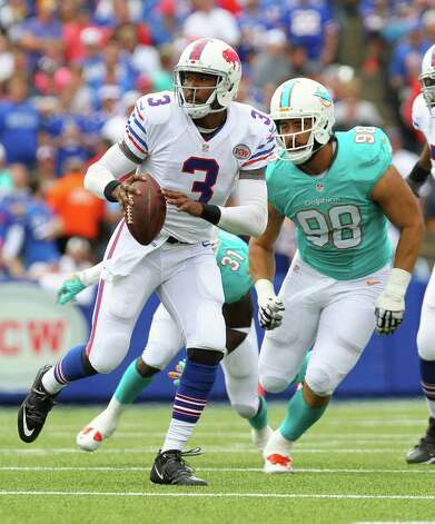 Buffalo Bills quarterback EJ Manuel (3) is pressured by Miami Dolphins defensive tackle Jared Odrick (98) during the first half of an NFL football game on Sunday, Sept. 14, 2014, in Orchard Park, N.Y. (AP Photo/Bill Wippert) ORG XMIT: NYMG107 Photo: Bill Wippert / FR170745 AP