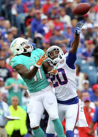 Buffalo Bills cornerback Corey Graham (20) breaks up a pass intended for Miami Dolphins wide receiver Mike Wallace (11) during the first half of an NFL football game on Sunday, Sept. 14, 2014, in Orchard Park, N.Y. (AP Photo/Bill Wippert) ORG XMIT: NYMG104 Photo: Bill Wippert / FR170745 AP