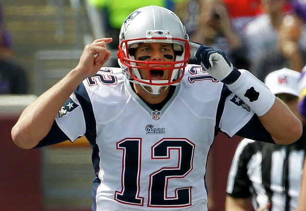 New England Patriots quarterback Tom Brady yells on the line of scrimmage during the first quarter of an NFL football game against the Minnesota Vikings, Sunday, Sept. 14, 2014, in Minneapolis. (AP Photo/Ann Heisenfelt) ORG XMIT: MNJR117 Photo: Ann Heisenfelt / FR13069 AP