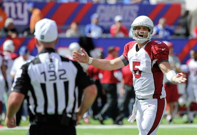 Arizona Cardinals quarterback Drew Stanton (5) yells after a play during the first half of an NFL football game against the New York Giants, Sunday, Sept. 14, 2014, in East Rutherford, N.J.  (AP Photo/Bill Kostroun) ORG XMIT: ERU116 Photo: Bill Kostroun / FR51951 AP