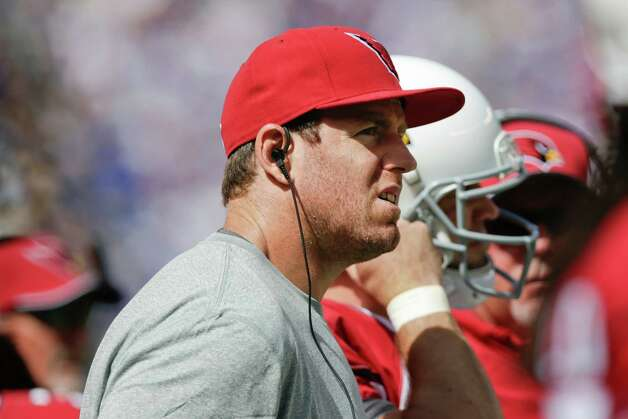 Arizona Cardinals quarterback Carson Palmer watches his team play during the first half of an NFL football game against the New York Giants, Sunday, Sept. 14, 2014, in East Rutherford, N.J. (AP Photo/Kathy Willens) ORG XMIT: ERU118 Photo: Kathy Willens / AP