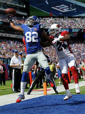 New York Giants wide receiver Rueben Randle (82) catches a pass for a touchdown in front of Arizona Cardinals' Patrick Peterson (21) during the first half of an NFL football game Sunday, Sept. 14, 2014, in East Rutherford, N.J. (AP Photo/Kathy Willens) ORG XMIT: ERU112 Photo: Kathy Willens / AP