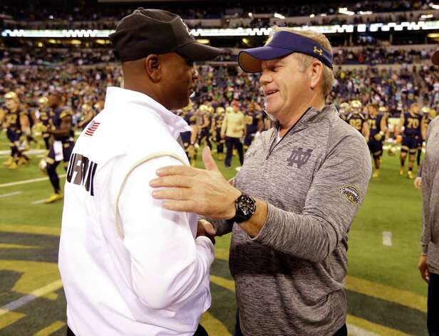 Notre Dame coach Brian Kelly, right, greets Purdue coach Darrell Hazell following an NCAA college football game in Indianapolis, Saturday, Sept. 13, 2014. Notre Dame defeated Purdue 30-14. (AP Photo/Michael Conroy) ORG XMIT: INMC119 Photo: Michael Conroy / AP