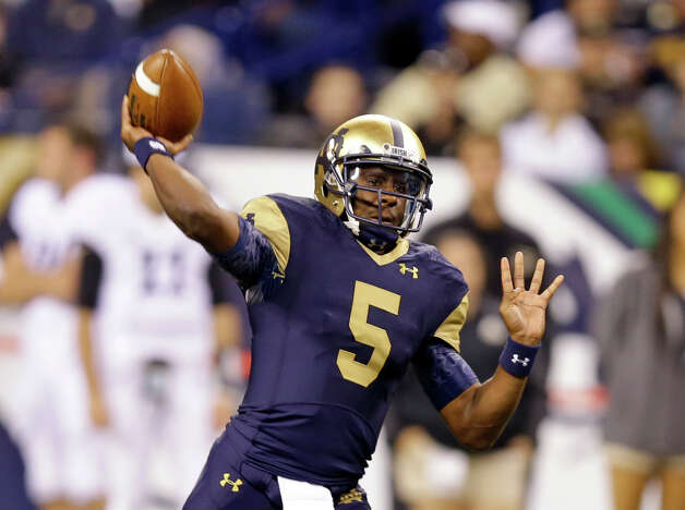 Notre Dame quarterback Everett Golson throws against Purdue during the first half of an NCAA college football game in Indianapolis, Saturday, Sept. 13, 2014. (AP Photo/Michael Conroy) ORG XMIT: INMC110 Photo: Michael Conroy / AP