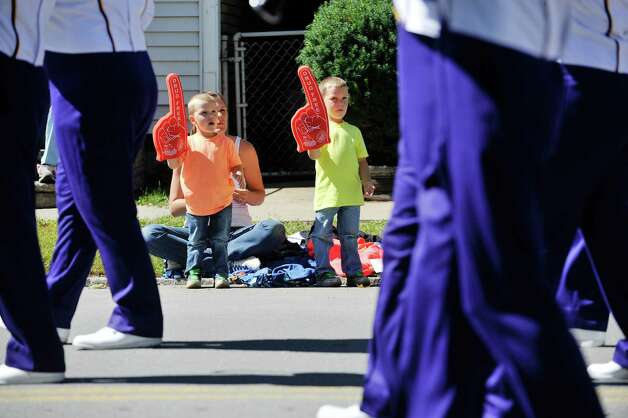 Jessica Tokarz and her sons, Blake, left, and Cameron watch as a marching band heads down Fifth Ave. during the 39th annual Uncle Sam Parade on Sunday, Sept. 14, 2014, in Lansingburgh, N.Y.  (Paul Buckowski / Times Union) Photo: Paul Buckowski / 00028585A