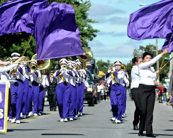 Members of the University at Albany Marching Great Danes band perform as they march down Fifth Ave. during the 39th annual Uncle Sam Parade on Sunday, Sept. 14, 2014, in Lansingburgh, N.Y.  (Paul Buckowski / Times Union) Photo: Paul Buckowski / 00028585A