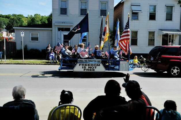 Members of the Northeast New York Chapter, Korean War Veterans Association head down Fifth Ave. past spectators  during the 39th annual Uncle Sam Parade on Sunday, Sept. 14, 2014, in Lansingburgh, N.Y.  (Paul Buckowski / Times Union) Photo: Paul Buckowski / 00028585A