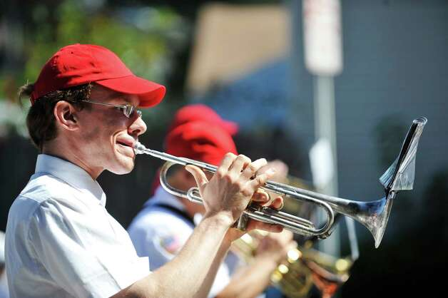 A member of The Red Caps marching band plays the trumpet during the 39th annual Uncle Sam Parade on Sunday, Sept. 14, 2014, in Lansingburgh, N.Y.  (Paul Buckowski / Times Union) Photo: Paul Buckowski / 00028585A