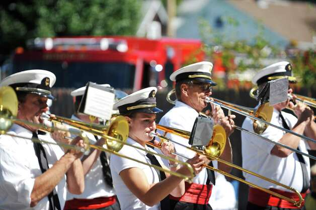 Members of The Fiesta Band out of Mechanicville, perform as they march down Fifth Ave. during the 39th annual Uncle Sam Parade on Sunday, Sept. 14, 2014, in Lansingburgh, N.Y.  (Paul Buckowski / Times Union) Photo: Paul Buckowski / 00028585A
