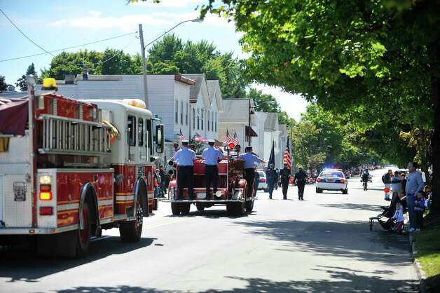 Troy Firefighters head down Fifth Ave. during the 39th annual Uncle Sam Parade on Sunday, Sept. 14, 2014, in Lansingburgh, N.Y.  (Paul Buckowski / Times Union) Photo: Paul Buckowski / 00028585A