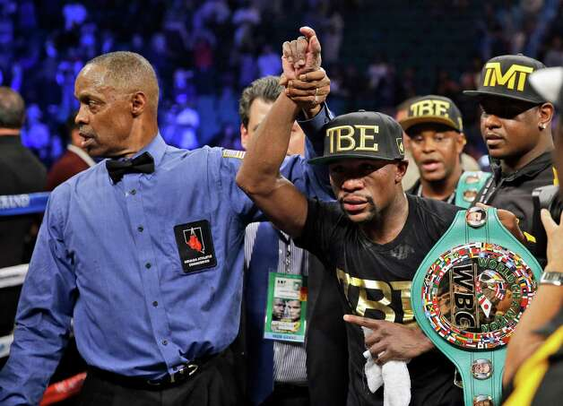 Floyd Mayweather shows off his belts after beating Marcos Maidana during their WBA welterweight and WBC super  welterweight title fight, Saturday, Sept. 13, 2014, in Las Vegas. (AP Photo/John Locher) ORG XMIT: NVSM159 Photo: John Locher / AP