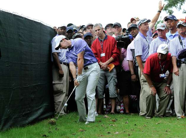 Rory McIlroy, of Northern Ireland, hits a shot on the ninth hole during the final round of the Tour Championship golf tournament Sunday, Sept. 14, 2014, in Atlanta. (AP Photo/John Amis) ORG XMIT: GAJB111 Photo: John Amis / FR170493 AP