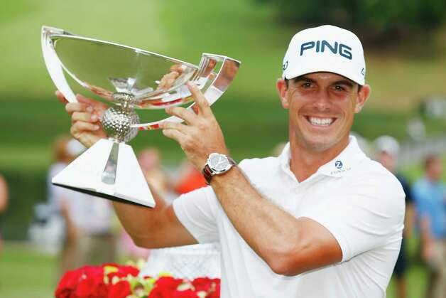 ATLANTA, GA - SEPTEMBER 14:  Billy Horschel of the United States poses with the FedExCup on the 18th green after winning both the TOUR Championship by Coca-Cola and the FedExCup Playoffs at the East Lake Golf Club on September 14, 2014 in Atlanta, Georgia.  (Photo by Sam Greenwood/Getty Images) ORG XMIT: 461926483 Photo: Sam Greenwood / 2014 Getty Images