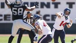 Houston Texans quarterback Ryan Fitzpatrick (14) fires a pass over Oakland Raiders defensive end LaMarr Woodley (58) during the second quarter of an NFL football game at O.co Coliseum on Sunday, Sept. 14, 2014, in Oakland, Calif. ( Brett Coomer / Houston Chronicle )