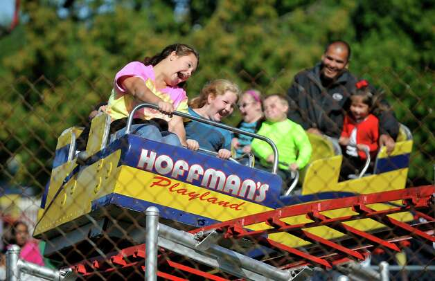 Cousins, Madison Campbell, left, 12, from Troy and Katie Carney, 8, from Stillwater ride the roller coaster during the final day of business at Hoffman's Playland, on Sunday, Sept. 14, 2014, in Latham, N.Y.  The business first opened in 1952.  (Paul Buckowski / Times Union) Photo: Paul Buckowski / 00028503A
