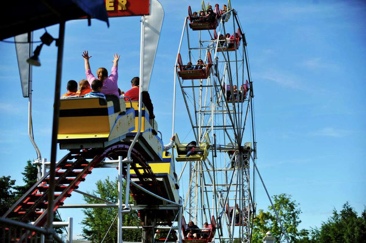 Adults and children take rides on the roller coaster and the ferris wheel during the final day of business at Hoffman's Playland, on Sunday, Sept. 14, 2014, in Latham, N.Y. The business first opened in 1952. (Paul Buckowski / Times Union)