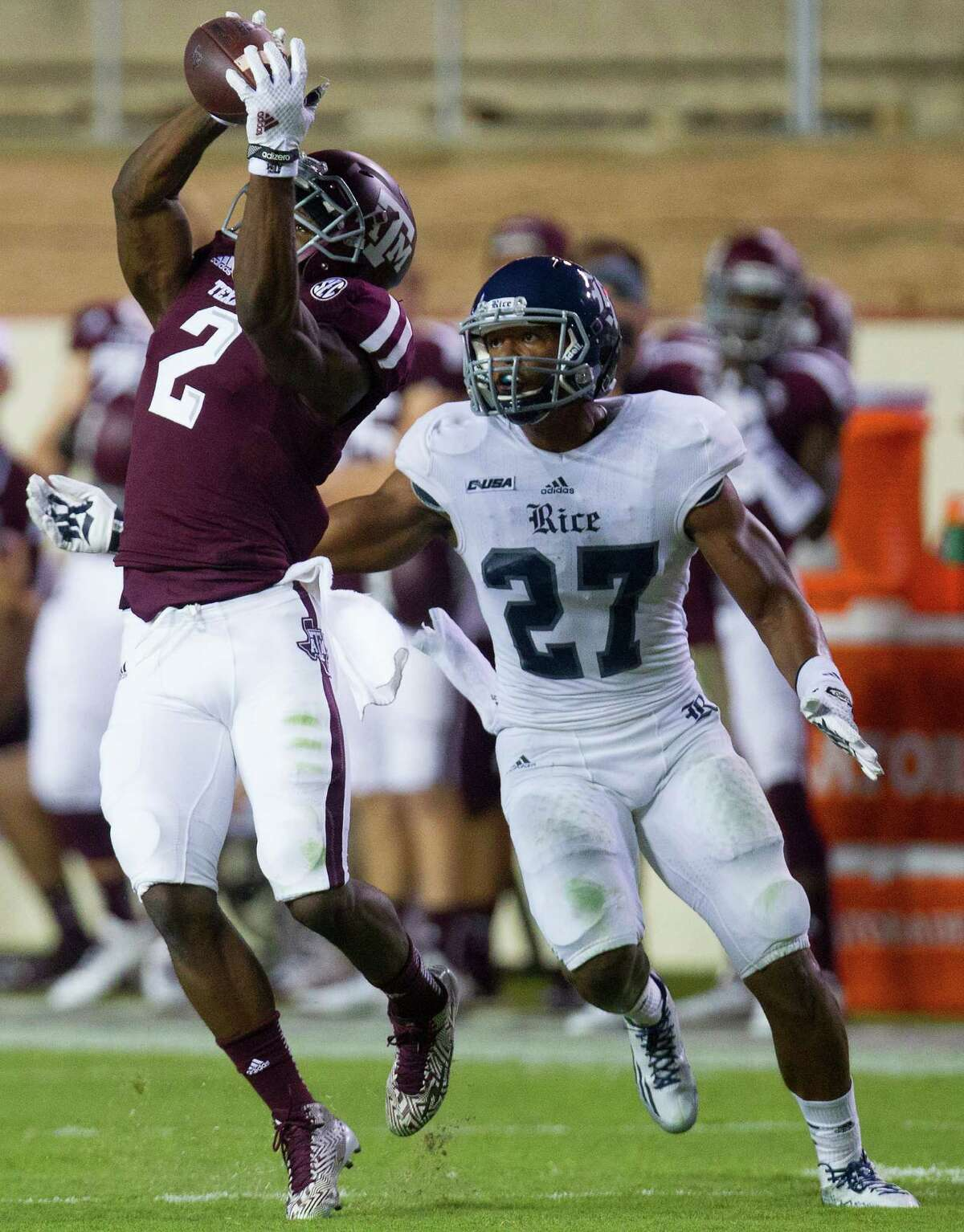 Before leaving with an undisclosed injury that could not be attributed to the poor playing surface at Kyle Field, A&M's Speedy Noil gets inside Rice's Gabe Bakers and makes one of his three catches on Saturday night.