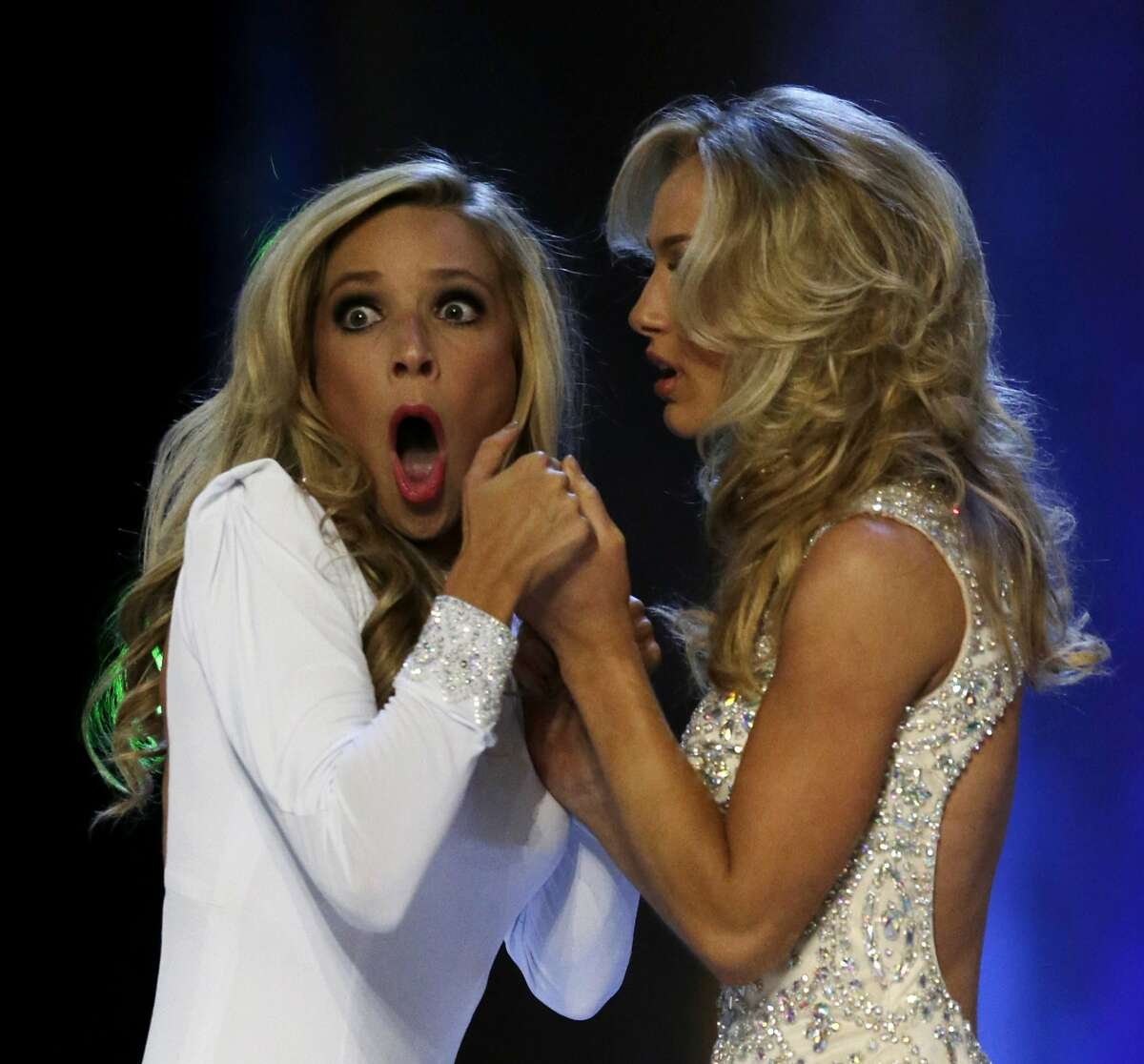 Miss New York Kira Kazantsev, left, gasps after she was named Miss America 2015 as she holds hands with Miss Virginia Courtney Paige Garrett during the Miss America 2015 pageant, Sunday, Sept. 14, 2014, in Atlantic City, N.J. (AP Photo/Julio Cortez)