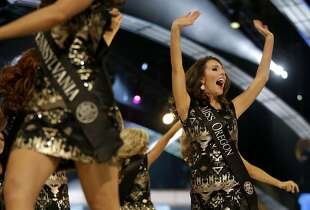 Miss Oregon Rebecca Anderson takes the stage with contestants during the Miss America 2015 pageant, Sunday, Sept. 14, 2014, in Atlantic City, N.J. (AP Photo/Julio Cortez)